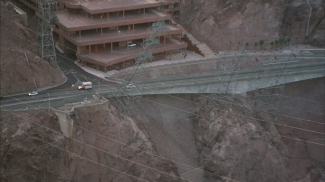 A white delivery car drives on the Hoover Dam road.
