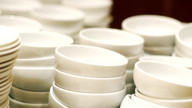 white dishware stacks of clean bowls and plates. - ceramics stock videos & royalty-free footage