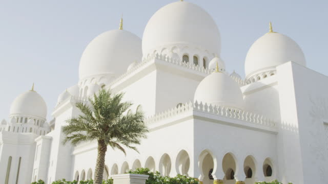 white domes top the roof of the abu dhabi sheikh zayed grand mosque. - grand mosque stock videos and b-roll footage