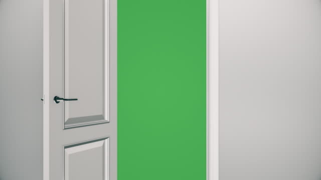 white door opening to green screen - empty room | 4k - white color stock videos & royalty-free footage