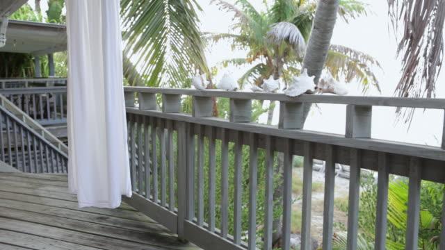 ms pan white dress hanging on porch / florida keys, florida, united states  - white dress stock videos & royalty-free footage