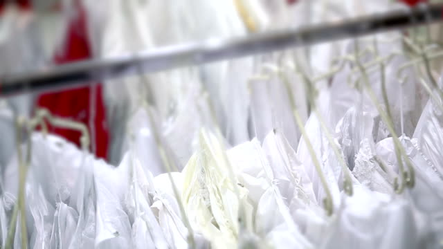 white dresses on hanger in the store - wedding dress stock videos and b-roll footage