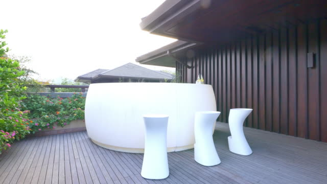 white elegant table and stool on patio of modern villa 4k - marble wall stock videos and b-roll footage