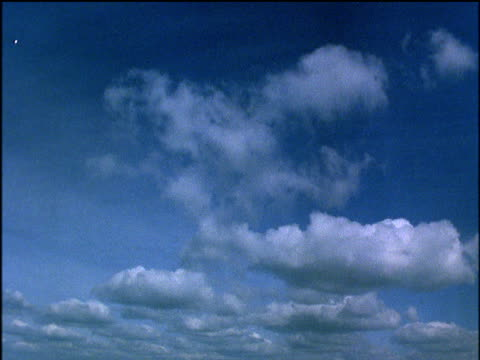 stockvideo's en b-roll-footage met white fair weather cumulus clouds move towards camera across blue sky no horizon visible - 1991