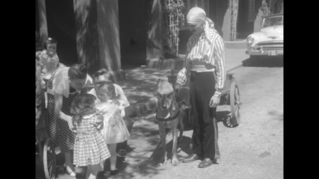 ms white female toddlers wearing dresses and mary jane shoes stand in row and eat ice cream on a stick / ms toddlers run towards camera pan down to... - shoes in a row stock videos & royalty-free footage