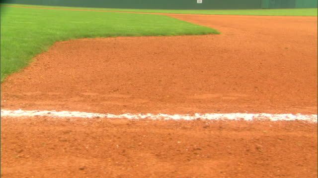 white first base foul line stripe on empty baseball field field maintenance field lining sports major league baseball mlb - baseball diamond stock videos and b-roll footage
