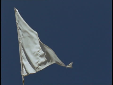 CU white flag flying in blue sky on top of temple, Bandhavgarh National Park, India