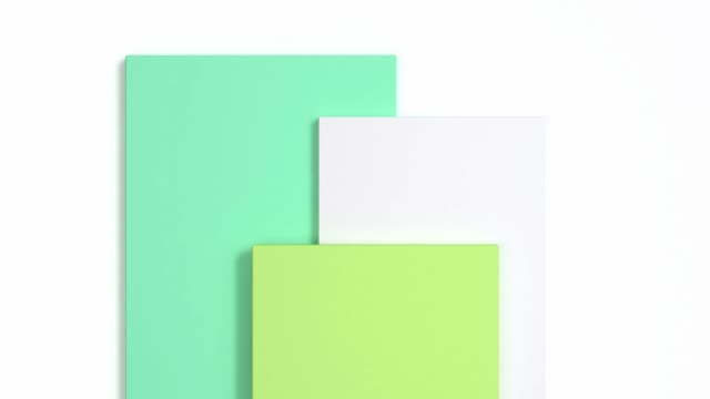 white flat lay scene green geometric shape motion 3d rendering - flat lay stock videos & royalty-free footage