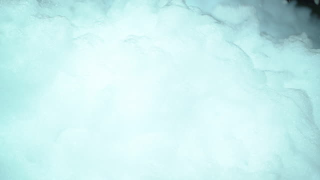 white foam from soap blowing in air - shampoo stock videos & royalty-free footage