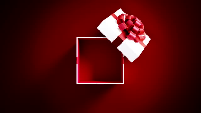 white gift box opening on red background in 4 k resolution - sorpresa video stock e b–roll