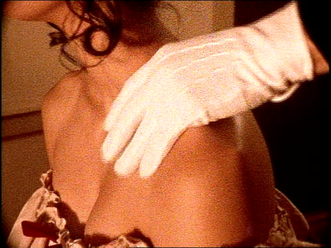 white gloved hand rubbing on woman's shoulder - seduction stock videos & royalty-free footage