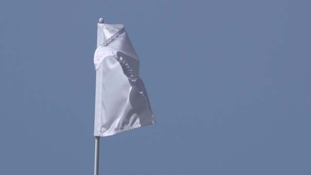 """white golf flag in the wind, near sciacca in sicily, italy, slow motion"" - 旗点の映像素材/bロール"