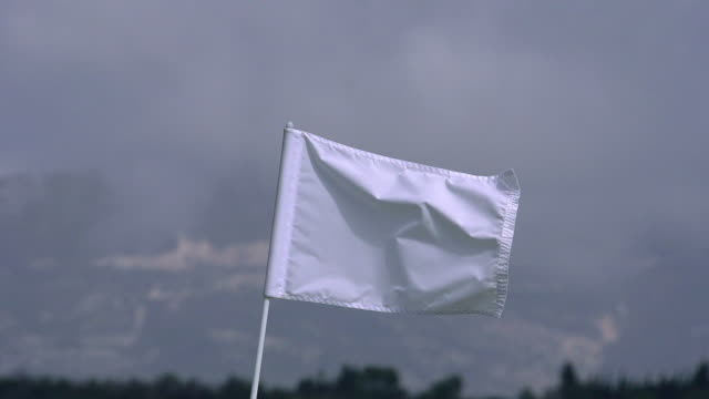 """white golf flag in the wind, near sciacca in sicily, italy, slow motion"" - flag blowing in the wind stock videos & royalty-free footage"
