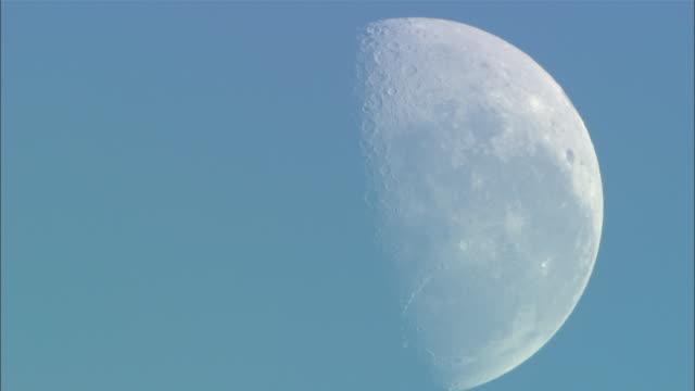 ms, white half moon against blue sky - half moon stock videos & royalty-free footage
