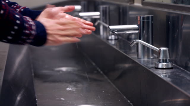 white hands washing hands in sink - public restroom stock videos and b-roll footage