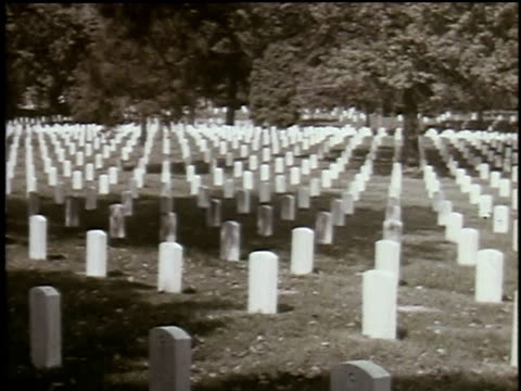 1965 MONTAGE White headstones dot the hills in a military cemetery
