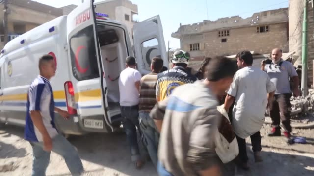 white helmets civil defense agency members rescue survivors from the rubble of buildings after russian jets struck a marketplace in idlib province's... - air raid点の映像素材/bロール