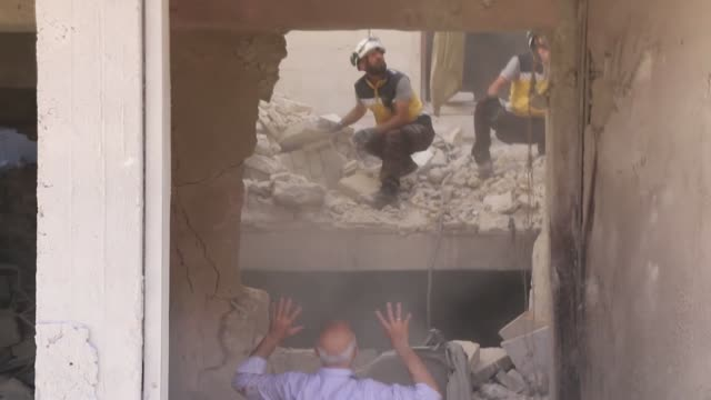 white helmets civil defense agency members search for survivors in the rubble of buildings after russian jets struck a marketplace in idlib... - ruined stock videos & royalty-free footage