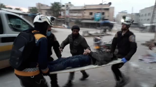 white helmets members conduct search and rescue operation after russian and regime forces carried out air strikes in de-escalation zone in idlib,... - 空爆点の映像素材/bロール