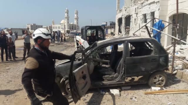 white helmets members work at the site of a car bomb attack outside an office of the usbased international rescue committee in idlib's dana district... - bomb bildbanksvideor och videomaterial från bakom kulisserna