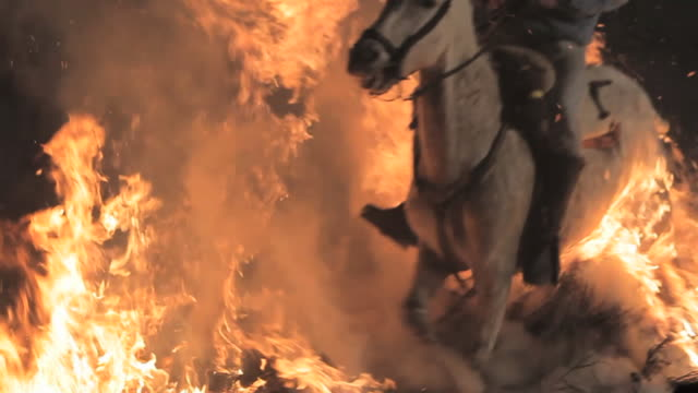 L/S White horse and rider crossing the flames