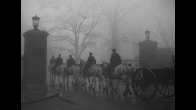 VS white horses pull caisson of British Ambassador Philip Henry Kerr as his ashes arrive at Arlington National Cemetery on rainy foggy day /...