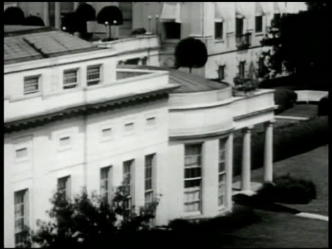 white house building ext ws white house wing int ws us president harry s truman at desk in oval office vs truman w/ man looking at signing paper work - 1972 stock videos & royalty-free footage
