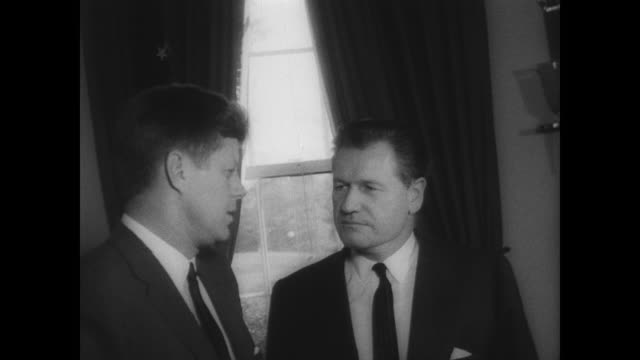 ext white house / int president kennedy meets with governor nelson rockefeller in oval office / cameras flash as the two seated men talk / men stand... - ネルソン a ロッカフェラー点の映像素材/bロール