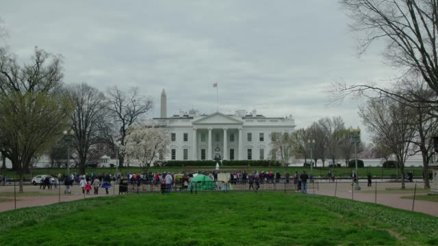 white house north facade lawn and washington monument in washington, dc in 4k/uhd - white house washington dc stock videos & royalty-free footage