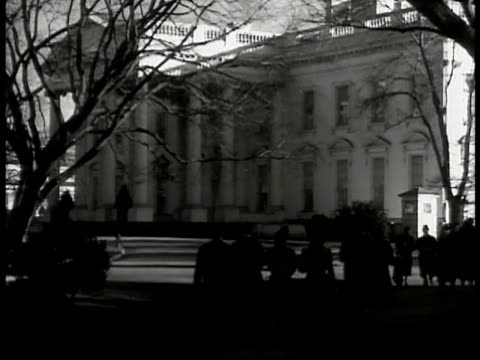 white house pedestrians fg. int president franklin d. roosevelt holding press conference in oval office reporters. reporters standing w/ notepads.... - 1940 stock videos & royalty-free footage