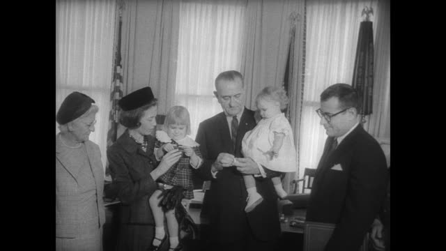 stockvideo's en b-roll-footage met ext white house where president johnson is honoring deceased military veteran joseph baggett / president johnson presents the medal to widow nancy... - weduwe