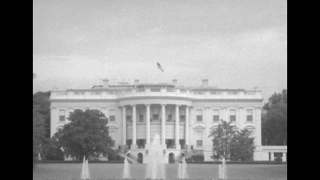 ws white house with flag at halfstaff above in honor of recently deceased sen robert a taft and fountains bubbling in foreground / ms south portico /... - passing a note stock videos and b-roll footage