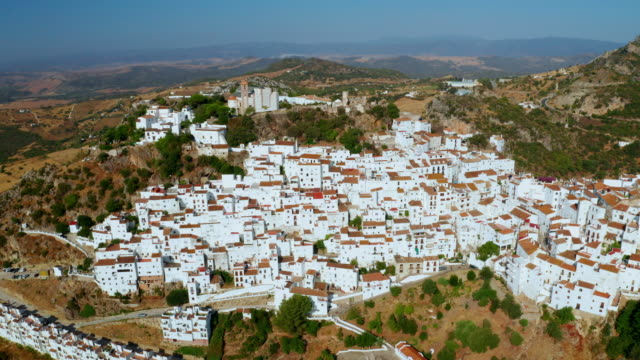 white houses, church and mountains, casares, andalusia, spain - spanish culture stock videos & royalty-free footage