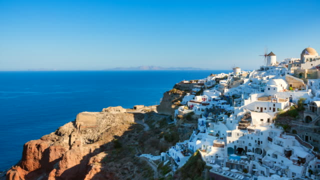 WS white houses clinging to cliff top overlooking mediterranean sea
