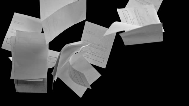 slo mo white invoice sheets colliding on black background - document stock videos & royalty-free footage
