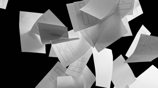 vídeos de stock e filmes b-roll de slo mo white invoice sheets falling on black background - papelada