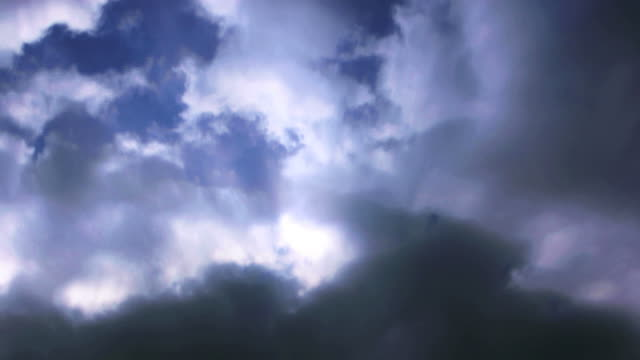 white light bursts through stormy clouds. - digital enhancement stock videos & royalty-free footage