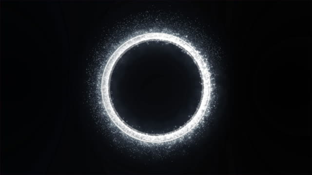 White Light with Sparkle and Smoke Trail Creates a Round Metallic Three-dimensional Ring. Black Background.