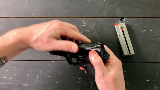 white male racking a 9mm hand gun - old fashioned stock videos & royalty-free footage