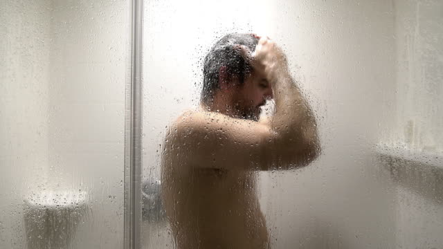 White mature man take shower in the hotel room