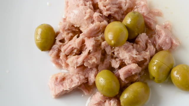 white meat tuna in olive oil and green olives salad - salad oil stock videos & royalty-free footage