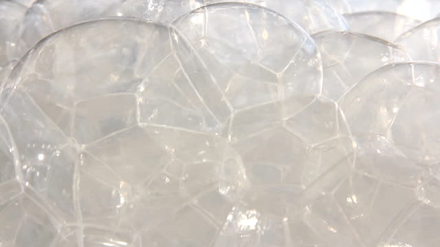 white milk bubbles building in macro with focus pull - frothy drink stock videos and b-roll footage