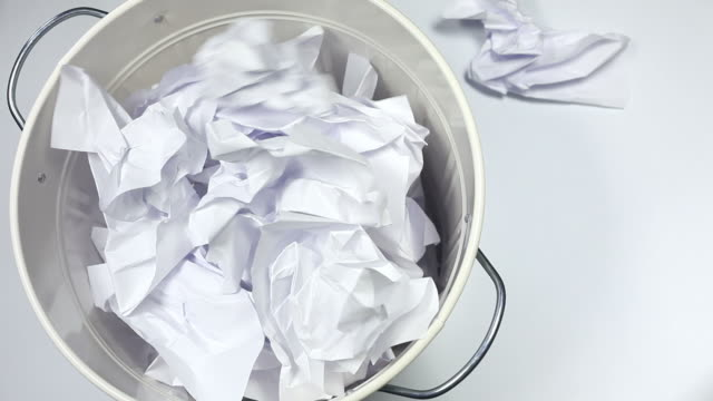 white paper falling into the garbage can - dustbin stock videos & royalty-free footage