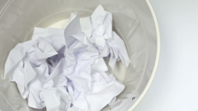 white paper falling into the trash can - close up - wastepaper bin stock videos & royalty-free footage