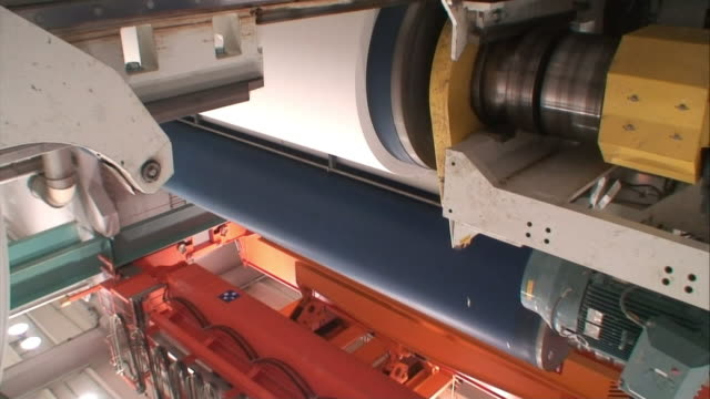 white paper wraps around rollers at a paper mill. - pulp stock videos & royalty-free footage