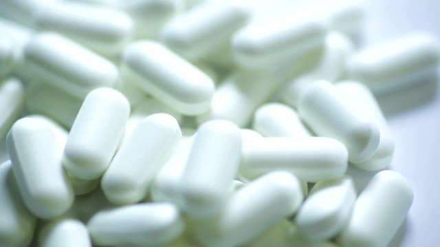 white pills... - paracetamol stock videos and b-roll footage