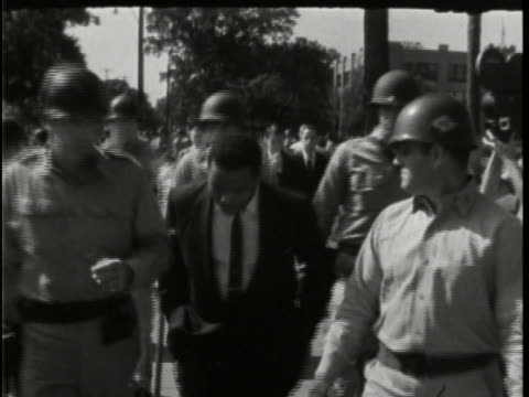 white protesters against integration crowd outside little rock central high school as national guardsmen form a cordon so that african-american... - caucasian ethnicity stock videos & royalty-free footage