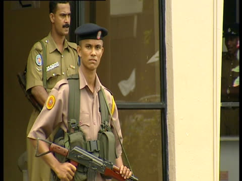 white ribbons and flags of mourning line the streets following a tamil tiger suicide attack on a police station which killed four officers. - sri lanka stock videos & royalty-free footage