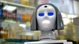 A white robots head during its work at a drugstore.