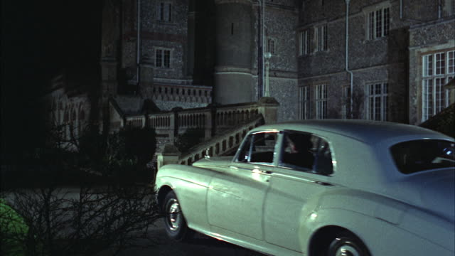 1966 ws zi white rolls royce pulling in front if castle at night - rolls royce stock videos and b-roll footage